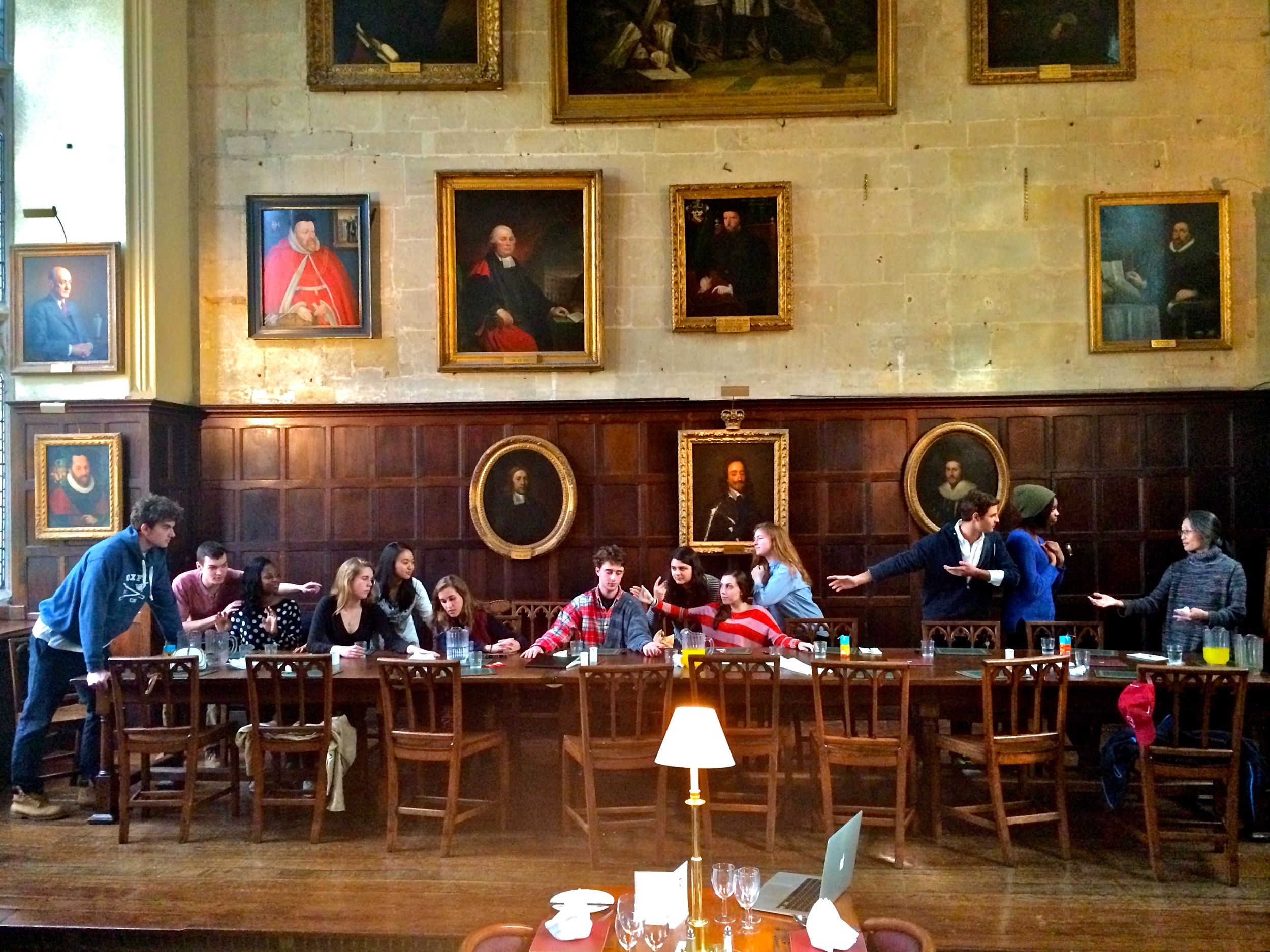 "Taking a break in Exeter College's dining hall, the group recreates Da Vinci's ""Last Supper."""
