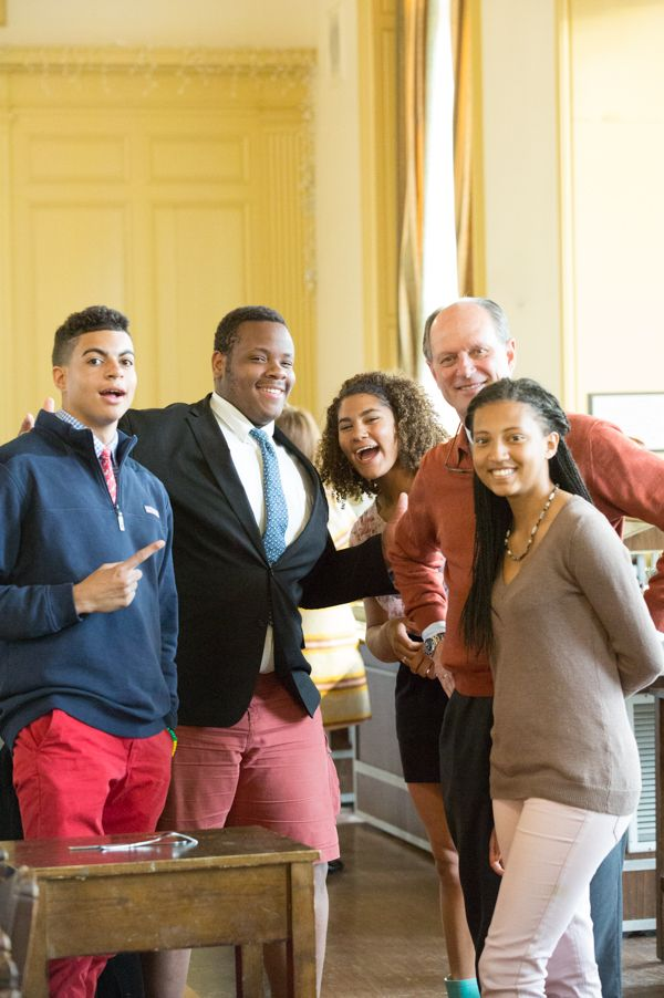 Dr. Ballard poses with a group of enthusiastic students in the Dining Hall.