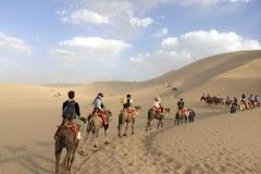 Camel Ride over Sand Dunes China Kelly