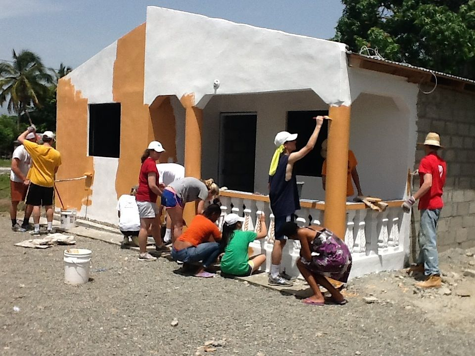 The team puts the final coat of paint on the house Photo Credit: Sheryl Cabral