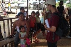 Phillip talking with Amazon locals Envoys