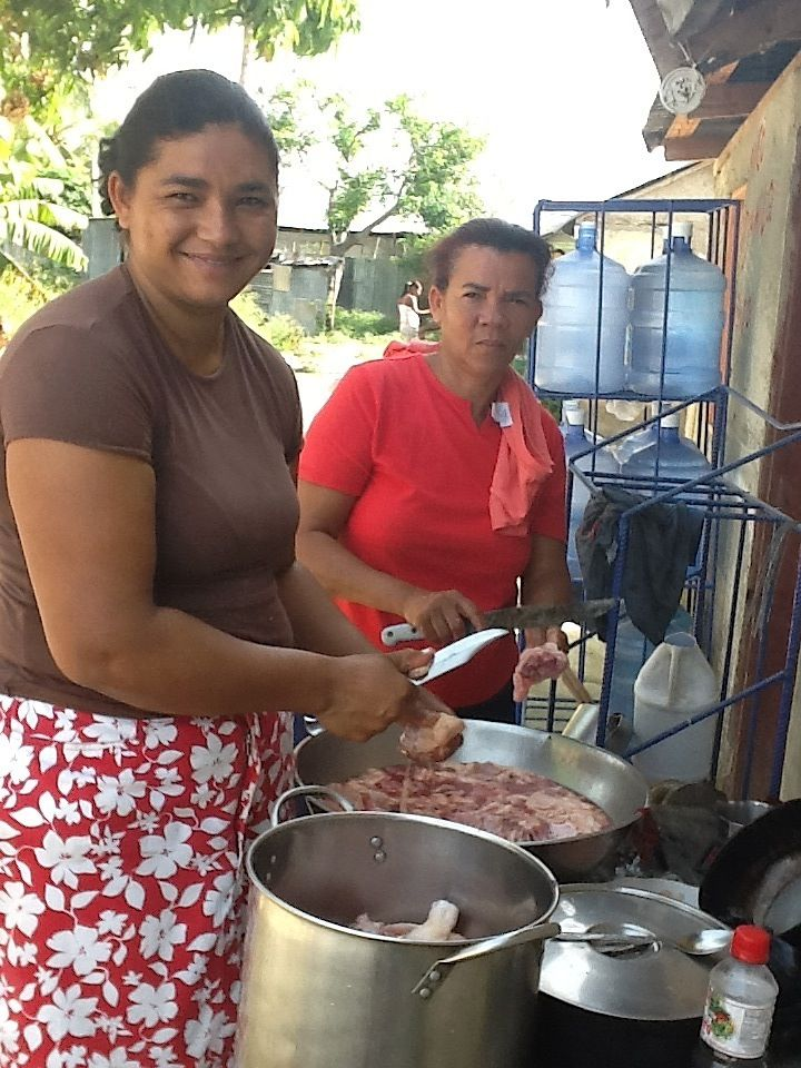 The family prepares dinner in their new house to celebrate its completion.   Photo Credit: Sheryl Cabral