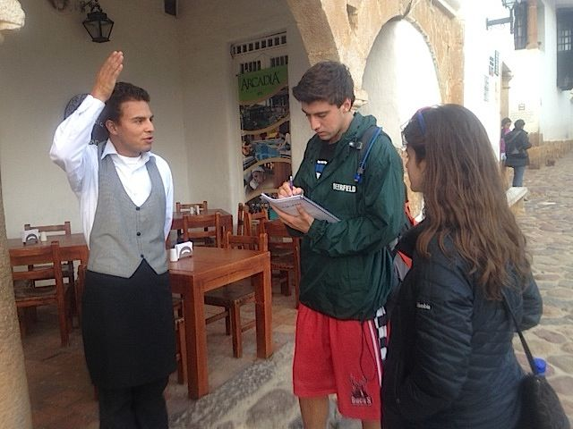 With the help of a student from Los Nogales, Ryan Collins '15 interviews a resident of Villa de Leyva. Photo Credit: David Thiel