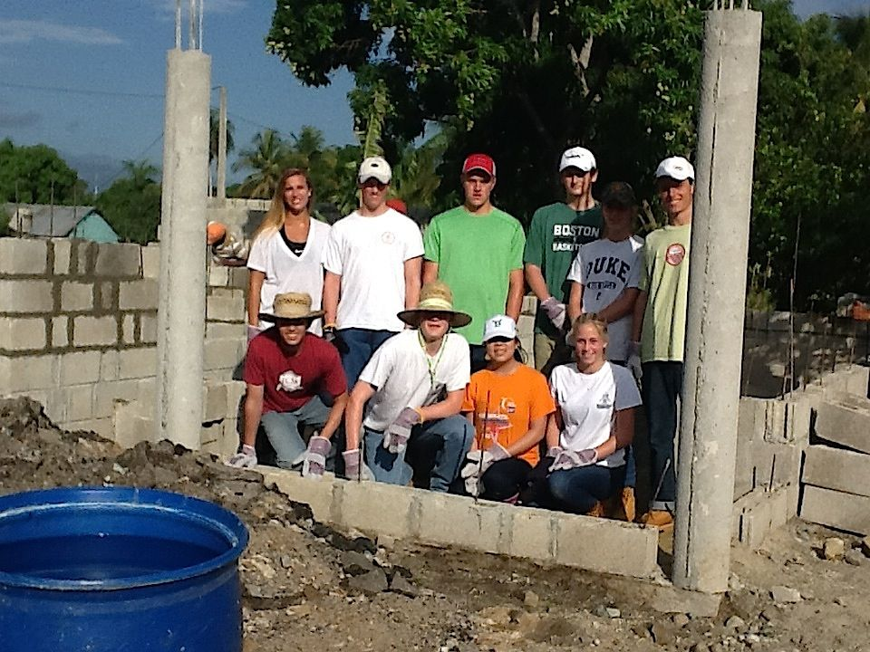 Photo Credit: Sheryl Cabral The goal for the day was to stack eleven rows of cinder blocks with mortar that would become the walls of the house. Under the sweltering sun we demonstrated teamwork by using assembly lines and working with the locals to construct the walls.